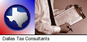 Dallas, Texas - a tax consultant holding an IRS form 1040