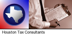 Houston, Texas - a tax consultant holding an IRS form 1040