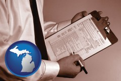 michigan map icon and a tax consultant holding an IRS form 1040