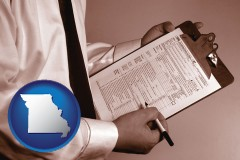 missouri map icon and a tax consultant holding an IRS form 1040