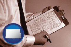north-dakota map icon and a tax consultant holding an IRS form 1040
