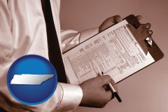 tennessee map icon and a tax consultant holding an IRS form 1040