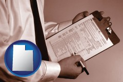 ut map icon and a tax consultant holding an IRS form 1040
