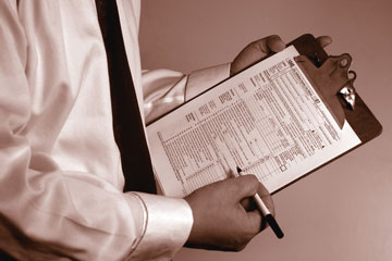 a tax consultant holding an IRS form 1040